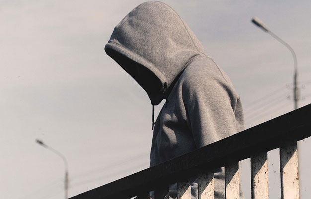 wearing hood - Empowering the Enemy: How You End Up Helping Your Abuser